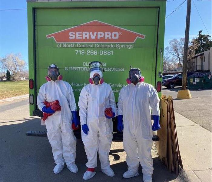 3 team members in front of SERVPRO truck.