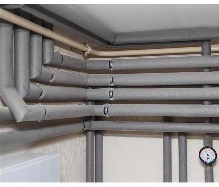 Image of pipes against a white wall