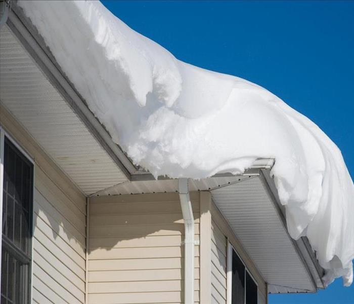 Image of snow on top of residential roof