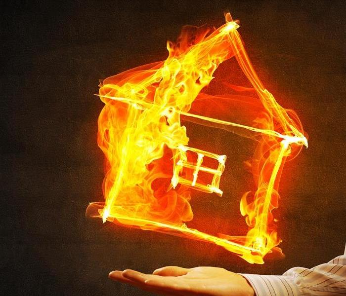 Image of a house covered in fire